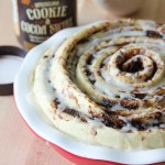 giant spiral cinnamon roll with vanilla maple glaze